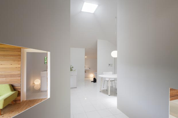 white interior small house by ACAA